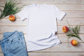Unisex T-shirt mockup with grass and red apples - PhotoDune Item for Sale