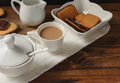 Coffee cup and cookies on a tray on wooden table - PhotoDune Item for Sale