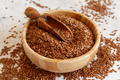 Raw Flax seeds in a bowl with a spoon - PhotoDune Item for Sale