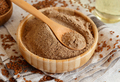Raw Flax seeds flour in a bowl with a spoon - PhotoDune Item for Sale