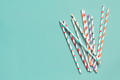 Striped and dotted paper drinking straws on green background top view - PhotoDune Item for Sale