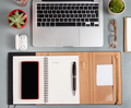 Laptop, cell phone and opened agenda on a grey desk top view - PhotoDune Item for Sale
