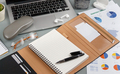Opened agenda near laptop and modern gadgets on a grey close up - PhotoDune Item for Sale