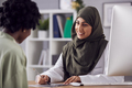 Female Doctor Or Consultant Wearing Headscarf Having Meeting With Female Patient To Discuss Scans - PhotoDune Item for Sale