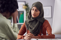 Female Doctor Or Consultant Wearing Headscarf Having Meeting With Unhappy Female Patient - PhotoDune Item for Sale