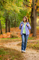 Middle aged active caucasian female model with backpack walk in woods autumn time - PhotoDune Item for Sale