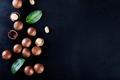 Australian peeled and whole macadamia nut with green leaves - PhotoDune Item for Sale