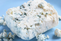 Dor blue cheese with mold on blue plate - PhotoDune Item for Sale