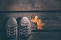 Conceptual image of legs in boots and autumn leaves. - PhotoDune Item for Sale