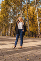 Woman talking on phone in the park. - PhotoDune Item for Sale