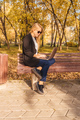Young businesswoman working on bench in park. - PhotoDune Item for Sale