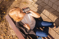 Young businesswoman drink coffee on bench. Above. - PhotoDune Item for Sale