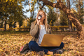 Young businesswoman working on nature with laptop. - PhotoDune Item for Sale