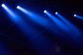Blue stage lights glowing in the dark. Live music festival concept background - PhotoDune Item for Sale