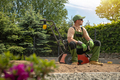 Gardener Relaxing After Backyard Lawn Aeration - PhotoDune Item for Sale