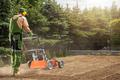 Professional Gardener Aerating Backyard Lawn - PhotoDune Item for Sale