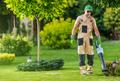 Gardener Blowing Leaves of the Lawn - PhotoDune Item for Sale