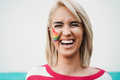 Portrait of gay woman smiling on camera at pride event - Focus on face - PhotoDune Item for Sale