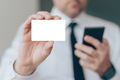 Businessman showing blank business card as mockup copy space - PhotoDune Item for Sale
