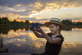 Girl in summer straw hat taking selfie for cellphone at sunset on lake, lifestyle, local travel - PhotoDune Item for Sale