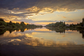 Gorgeous sunset over lake, water as a mirror, golden hours, twilight, local travel and nature - PhotoDune Item for Sale