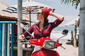 Charming beautiful girl wears red hat, sunglasses and stripped shirt, exploring exotic island - PhotoDune Item for Sale
