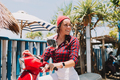 Portrait of adorable pretty woman dressed in stylish outfit traveling on motorbike on the island - PhotoDune Item for Sale