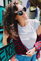 Lovely friendly woman with wavy hair dressed white t-shirt and shorts and sunglasses - PhotoDune Item for Sale
