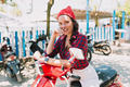 Happy incredible young woman dressed bright shirt, red cap and white jeans traveling on the bike - PhotoDune Item for Sale