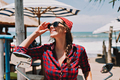 Pretty adorable woman travel on a tropical island by motocycle  has fun and smiles in sunshine - PhotoDune Item for Sale