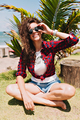 Happy adorable stylish pretty woman with curly dark hair dressed white t-shirt and denim shorts - PhotoDune Item for Sale