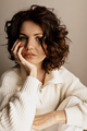 Beauty close up portrait of beautiful lady with healthy skin and curly hair wearing white blouse - PhotoDune Item for Sale