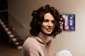 Close up inside portrait of happy smiling woman. Pleased brunette woman posing with  smile at home - PhotoDune Item for Sale
