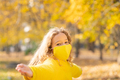 Happy child wearing protective mask in autumn park - PhotoDune Item for Sale
