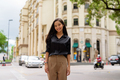 Portrait of beautiful Asian businesswoman smiling outdoors in city street while walking - PhotoDune Item for Sale