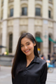 Vertical portrait of beautiful Asian businesswoman smiling outdoors in city street - PhotoDune Item for Sale