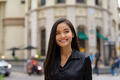 Portrait of beautiful Asian businesswoman outdoors in city street - PhotoDune Item for Sale