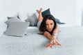 Lazy day for young beautiful woman in casual clothes that lying down at home on the bed - PhotoDune Item for Sale
