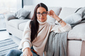Young beautiful woman in glasses sitting at home alone - PhotoDune Item for Sale