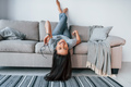 Young beautiful woman in casual clothes lying down on the bed and have fun at home alone - PhotoDune Item for Sale