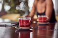 Close up view of cuo of tea on the table with african american woman sitting at background - PhotoDune Item for Sale