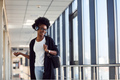 Young african american female passanger in casual clothes is in airport - PhotoDune Item for Sale