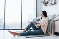 Young beautiful woman in glasses sitting at home alone with laptop - PhotoDune Item for Sale