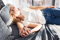 Young lovely couple lying down on bed together at home while spending weekend and holidays together - PhotoDune Item for Sale
