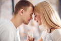 Young lovely couple together at home with champagne spending weekend and holidays together - PhotoDune Item for Sale