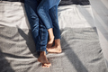 Close up view of young couple's legs on the bed at daytime - PhotoDune Item for Sale