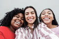 Happy latin girls having fun doing selfie together outdoor in city - Main focus on black girl face - PhotoDune Item for Sale