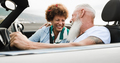 Happy senior couple having fun in convertible car during summer vacation - Focus on woman face - PhotoDune Item for Sale