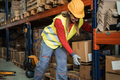 Latin woman worker loading delivery boxes inside warehouse - Main focus on carton package - PhotoDune Item for Sale