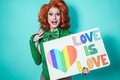 Happy drag queen holding gay pride banner - Lgbtq and concept - Focus on face - PhotoDune Item for Sale